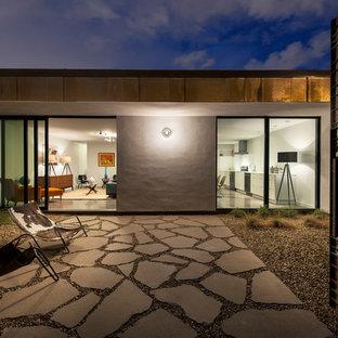 Patio - modern stone patio idea in Phoenix with no cover