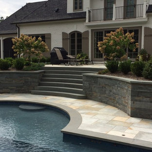 Example of a large classic backyard stone patio container garden design in New York