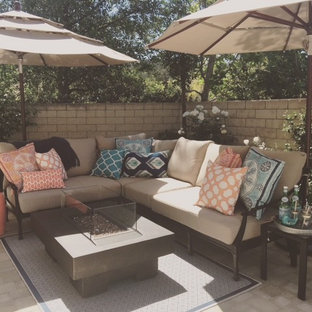 Patio - mid-sized farmhouse backyard stone patio idea in Los Angeles with no cover