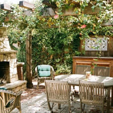 Rustic Patio by Robert Shuler Design
