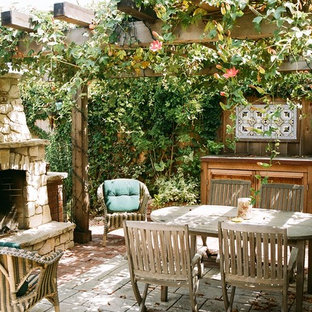 Patio - rustic patio idea in San Francisco with a fire pit and a pergola