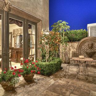 Patio - mediterranean patio idea in Los Angeles