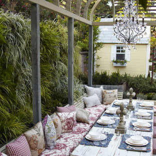 Photo of a shabby-chic style backyard patio in Melbourne with a pergola.