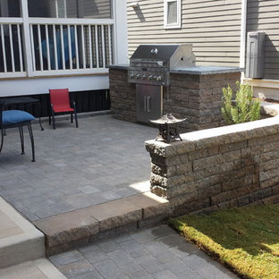 Inspiration for a small transitional front yard concrete paver patio kitchen remodel in Raleigh with no cover