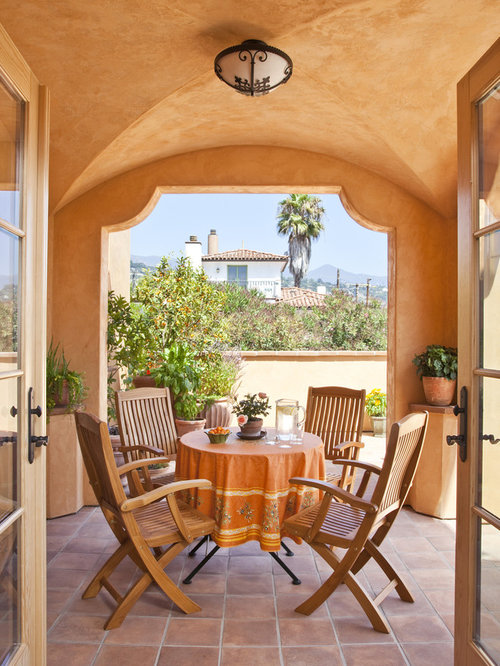 Tuscan Tile Patio Photo In Santa Barbara With A Roof Extension