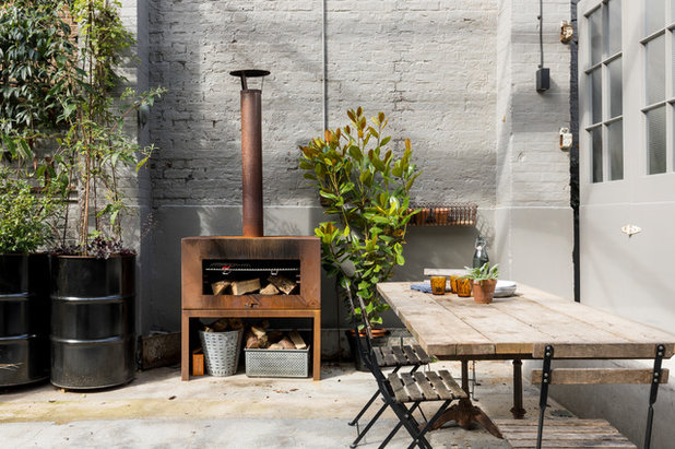 Industrial Patio by Imperfect Interiors