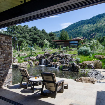 View of inner courtyard and waterfall from Living Room with Guest House beyond