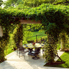 Mediterranean Patio by Walnut Hill Landscape Company