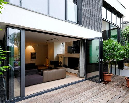Foto e idee per patii e portici patio o portico moderno for Idee di portico contadini