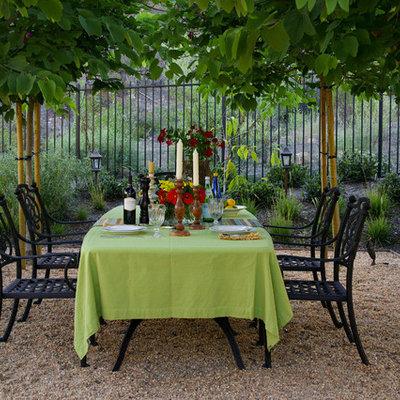 Patio - mediterranean gravel patio idea in Orange County