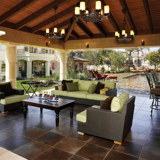 Tuscan patio kitchen photo in Los Angeles with a gazebo
