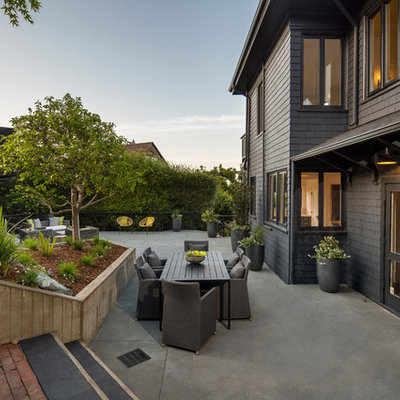 Patio - large transitional backyard concrete patio idea in San Francisco with no cover