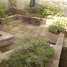 Traditional Patio by GARDEN INVADERS, LLC.