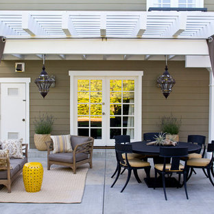 Transitional concrete patio photo in Los Angeles with a pergola