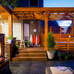Patio - contemporary patio idea in Portland with a fire pit and decking