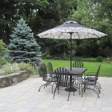 Traditional Patio by Enchanted Gardens
