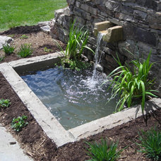Modern Patio by Poole's Stone and Garden, Inc.