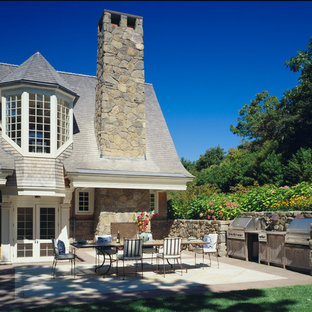 Patio kitchen - victorian stone patio kitchen idea in Boston with a roof extension