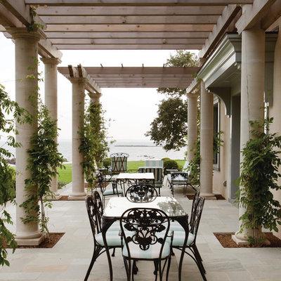 Patio - mediterranean patio idea in New York with a pergola