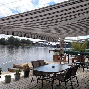 Design ideas for a large nautical back patio in Portland with an awning and decking.