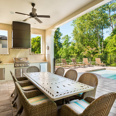 Transitional patio photo in Orlando with a roof extension