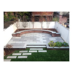Example of a large minimalist backyard concrete paver patio container garden design in New York with no cover