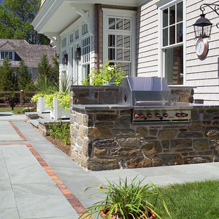 Victorian patio in Philadelphia with an outdoor kitchen and natural stone paving.