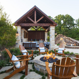 Design ideas for a large traditional courtyard patio in Dallas with an outdoor kitchen, concrete slab and a gazebo/cabana.