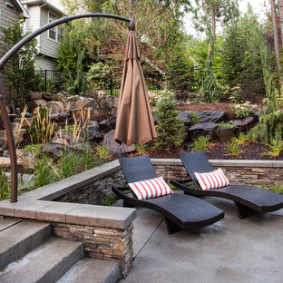 Inspiration for a contemporary concrete patio remodel in Seattle with no cover