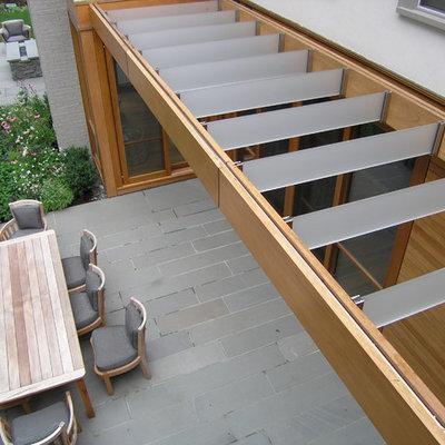 Inspiration for a contemporary patio remodel in Boston with a pergola