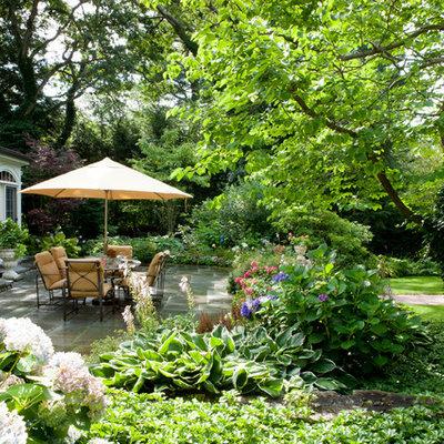 Patio - large traditional backyard concrete paver patio idea in Boston with no cover