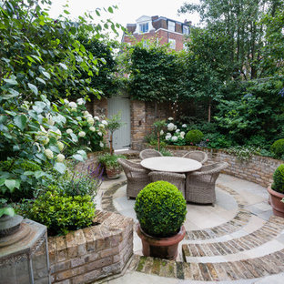 Design ideas for a small classic patio in London with brick paving.