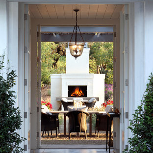 This is an example of an expansive country backyard patio in San Francisco with with fireplace.