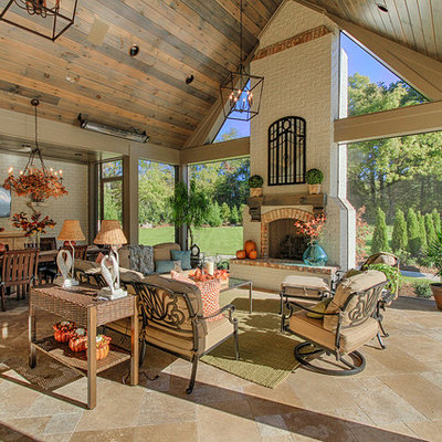 Patio - huge rustic patio idea in Other with a fire pit and a roof extension