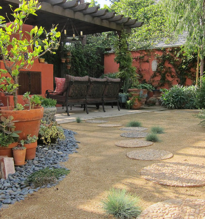 Eclectic Patio by Sandy Koepke