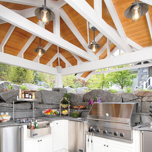 Inspiration for a timeless patio kitchen remodel in Other with a gazebo