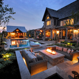 Patio - transitional patio idea in Toronto with a fire pit