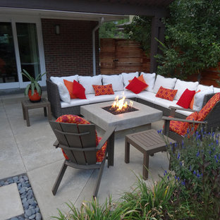 Photo of a contemporary patio in Denver with a fire feature and no cover.