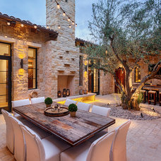 Mediterranean Patio by Liggatt Development, Inc
