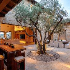 Mediterranean Patio by Liggatt Development, Inc