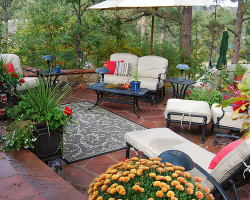 inspiration for a timeless backyard patio remodel in denver with natural stone pavers - Award Winning Patio Designs