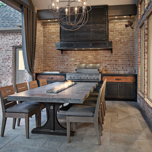 Patio kitchen - mid-sized transitional backyard stone patio kitchen idea in Houston with a roof extension