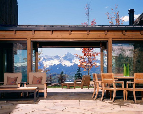 Large Rustic Backyard Patio Idea In Denver With Natural Stone Pavers