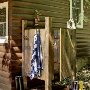 This is an example of a country patio in Minneapolis with an outdoor shower.