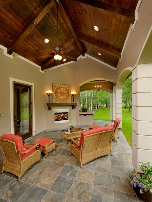 Example Of A Tuscan Patio Design In Houston With A Fire Pit