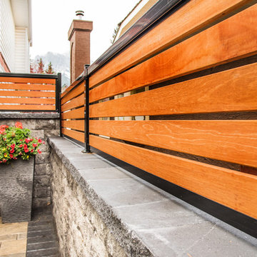 Wood Privacy Screen on Stone Wall