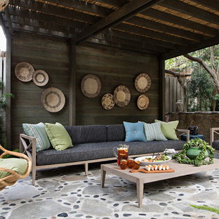 Inspiration for a coastal stone patio remodel in Orange County with a gazebo