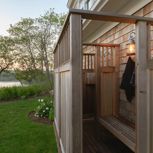 Photo of a mid-sized beach style side yard patio in Other with an outdoor shower and no cover.