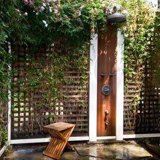 Design ideas for a mid-sized traditional backyard patio in San Francisco with natural stone pavers, an outdoor shower and no cover.