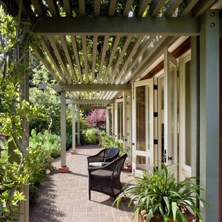 Inspiration for a timeless brick patio remodel in San Francisco with a pergola